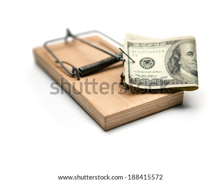 Activated mousetrap with money. Hypothec / studio photography of one hundred dollar bill and mousetrap on a white background  - stock photo