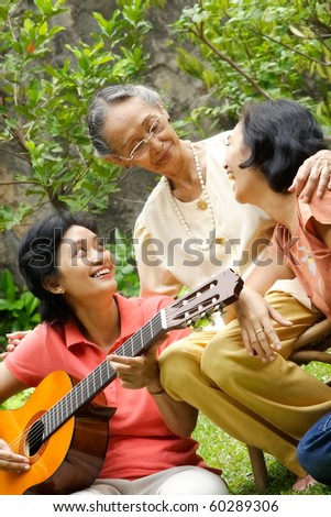 Active and healthy Asian senior woman together with daughter - stock photo