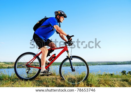Active bicyclist at the riverside