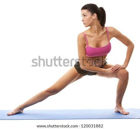 active brunette in yoga position on white isolated background - stock photo