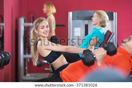 Active cheerful  smiling people  weightlifting training in modern health club - stock photo