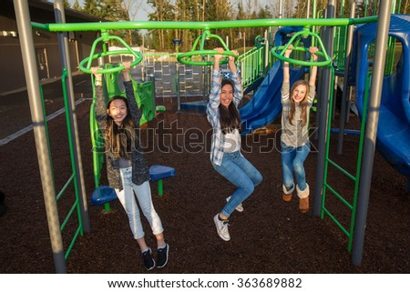 Active children playing outside at school playground - stock photo