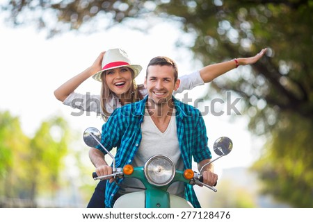 Active couple on a scooter outdoors