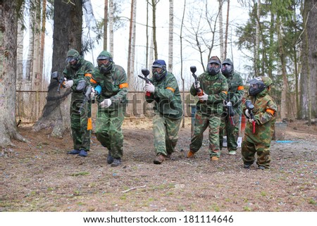 Active family on paintball start game - stock photo