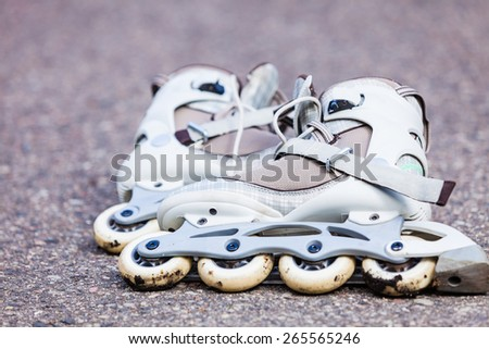 Active fun leisure in spring summer outdoor activities concept. Closeup roller skates on asphalt.