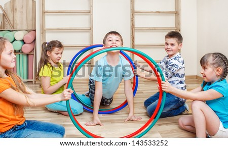 Active kids group in gym - stock photo