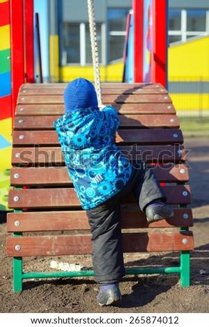 Active little boy on playground - stock photo
