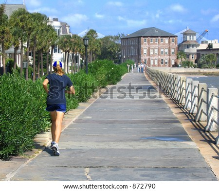Active locals and sightseers enjoy The Battery on the ocean in Charleston - stock photo