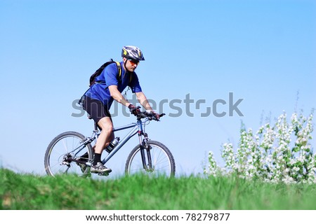 Active man bicyclist in the park