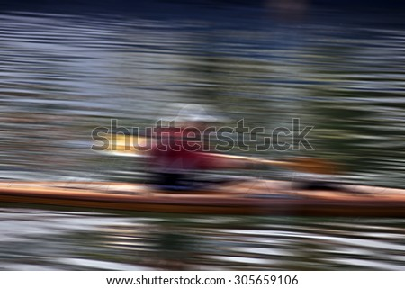 Active man kayaking in speed - stock photo