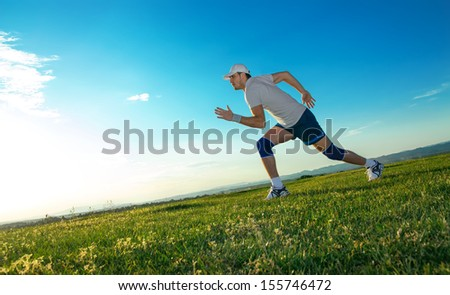 Active man ready for running, vitality runner on field