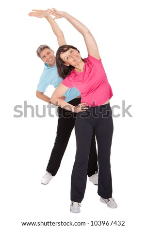 Active mature couple doing fitness. Isolated on white - stock photo