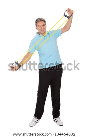 Active mature man doing exercises with expander. Isolated on white - stock photo