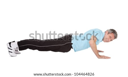Active mature man doing pushups. Isolated on white - stock photo