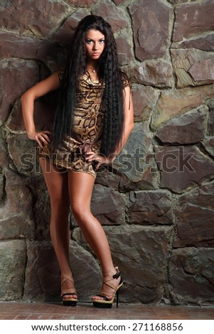 active model with a beautiful figure in full growth, fashionable clothes, photoshoot . beautiful long hair - stock photo