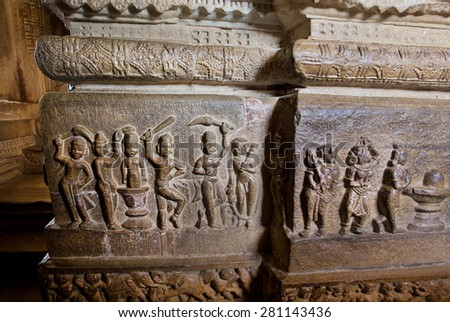 Active people make puja around Shiva lingam on the historical carved stone wall of hindu temple, India - stock photo