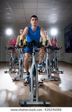 Active people on cycle indoors - stock photo