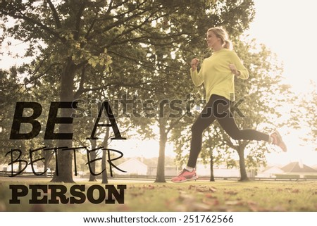 Active pretty blonde jogging against be a better person - stock photo
