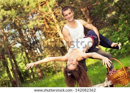 active rest young couples in park. outdoors portrait - stock photo