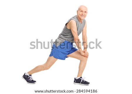 Active senior man doing stretching exercises and looking at the camera isolated on white background