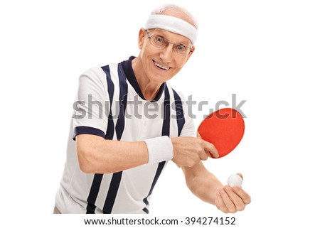 Active senior playing ping-pong and smiling isolated on white background - stock photo