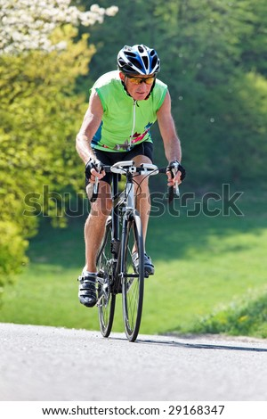 Active senior with bicycle for fitness