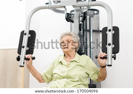 Active senior woman in a gym - stock photo