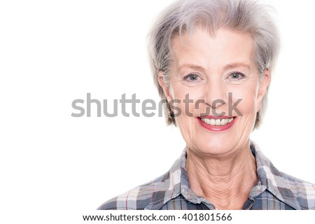 Active senior woman in front of white background - stock photo
