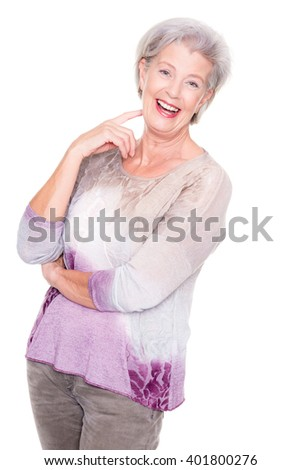 Active senior woman standing in front of white background  - stock photo