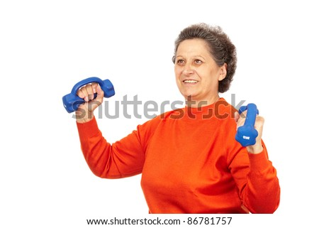 Active senior woman with dumbbells training, isolated on white - stock photo