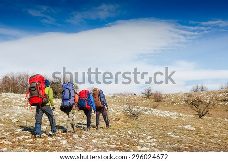 Active travelers in hike in the mountains. Sport lifestyle travel concept