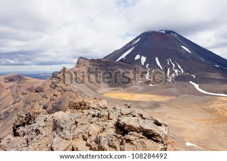 Active volcano cone of Mount Ngauruhoe as seen from Mount Tongariro in Tongariro National Park, North Island of New Zealand - stock photo