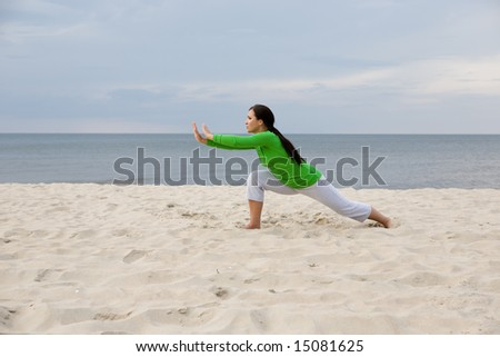 active woman doing exercise on the beach