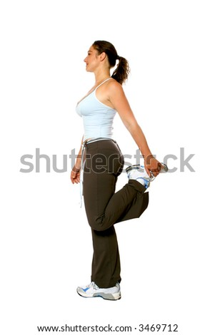 Active woman in athletic attire, doing her hamstring with her left leg, isolated on white. - stock photo