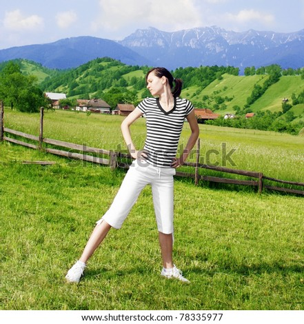 Active woman in the meadow - stock photo