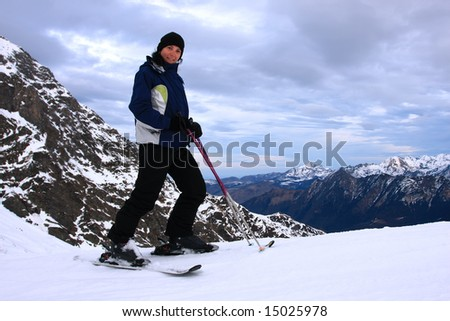 Active woman on a snowy mountain.