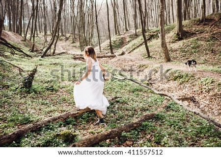 active woman walks alone on a large forest - stock photo