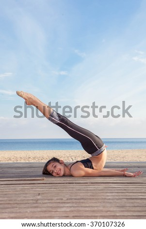 active young girl gymnast stretching - stock photo
