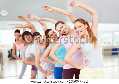 Active young people in fitness club - stock photo