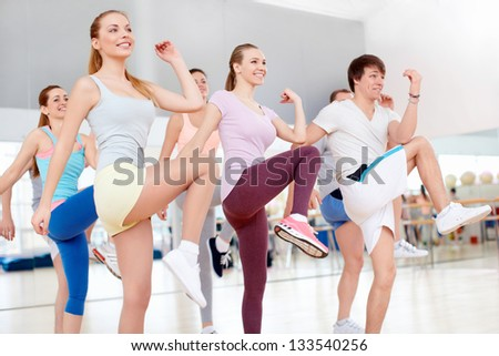 Active young people in the gym - stock photo