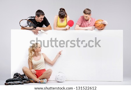 Active young people presenting a white board - stock photo