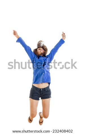 activity and happiness concept , successful smiling teenage girl or woman happy for her pure success in blue blank shirt and jeans shorts jumping with hands and arms high up