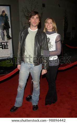 Actor DREW FULLER & girlfriend actress SARAH CARTER at the world premiere, in Hollywood, of The Perfect Score. January 27, 2004