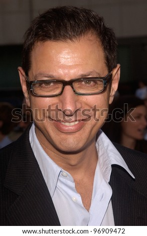 Actor JEFF GOLDBLUM & date at the Los Angeles premiere of The Manchurian Candidate. July 22, 2004