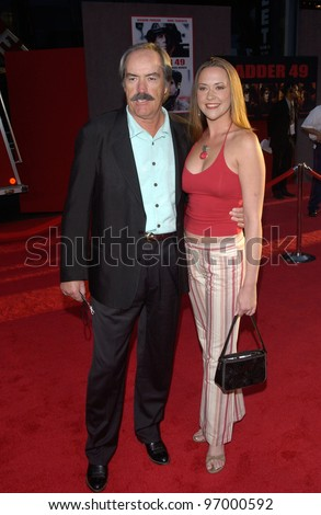 Actor POWERS BOOTHE & wife at the world premiere, in Hollywood, of Ladder 49. September 20, 2004