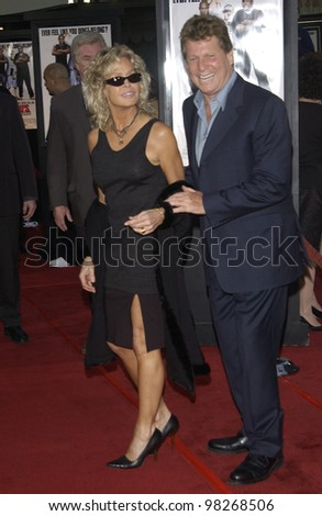 Actor RYAN O'NEAL & former wife actress FARRAH FAWCETT at the Los Angeles premiere of his new movie Malibu's Most Wanted. April 10, 2003 - stock photo