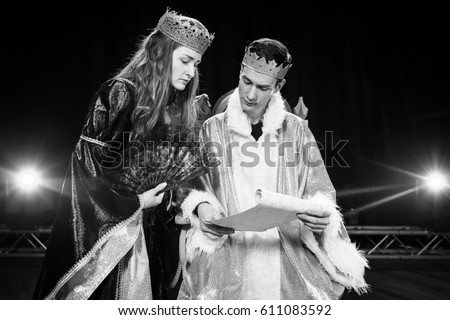 Actors. Costumes of the king and queen. Theater. Scene. King. Queen. Throne. Black and White