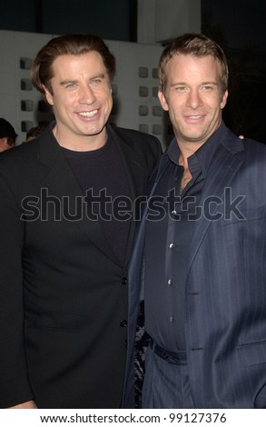 Actors JOHN TRAVOLTA (left) & THOMAS JANE at the Los Angeles premiere of their new movie The Punisher. April 12, 2004 - stock photo