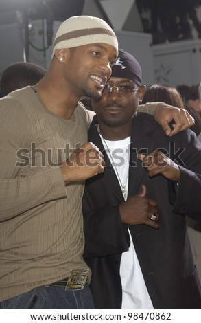 Actors MARTIN LAWRENCE (in black) & WILL SMITH at the world premiere, in Los Angeles, of his new movie Bad Boys II. July 9, 2003  Paul Smith / Featureflash - stock photo