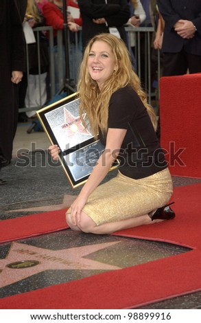 Actress DREW BARRYMORE on Hollywood Blvd where she was honored with the 2,246th star on the Hollywood Walk of Fame. She is the 5th Barrymore to have a star on the boulevard. February 3, 2004 - stock photo